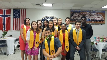 smiling students wearing gold CISL stoles