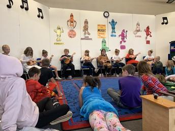 Students learning the ukulele