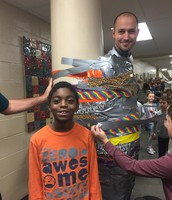 Darrian didn't want to put Tape on Mr. Foreman because he is a nice principal.