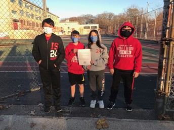 John, Louis, Jessica, and Ridley outside of I.S. 24 getting ready to distribute flyers to the community