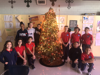 Our sweet 5th graders with their class Christmas Tree