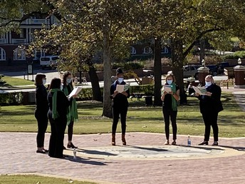 Members of Women's Ensemble on Front Campus