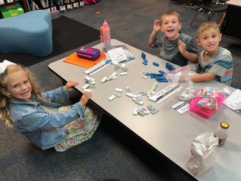 Students use dominoes in a math station.