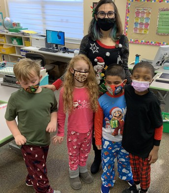 Ms. Carpenter with her 1st grade class, everyone wearing pajamas