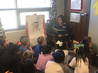 Mrs. Williams Enjoys Reading to the Students at the Primary