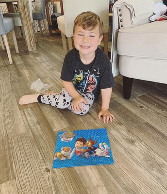 Max doing a puzzle