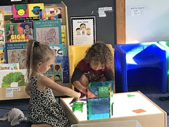 Pre-School students exploring their new classroom.