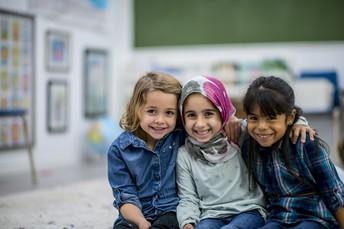 photo of three elementary children