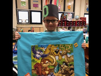 """Kindergarten student Christopher Boehnlein created a 100-piece puzzle poster to demonstrate his """"counting to 100"""" proficiency, as well as his creativity."""