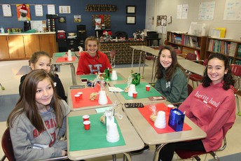 students doing Christmas crafts