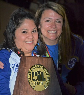 image of cheer coaches with 1st-place trophy