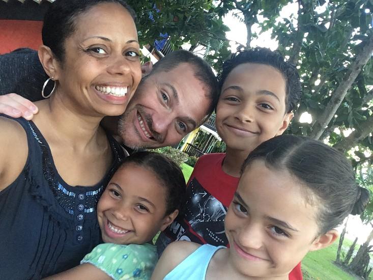 Sullivan school principal posing with her family