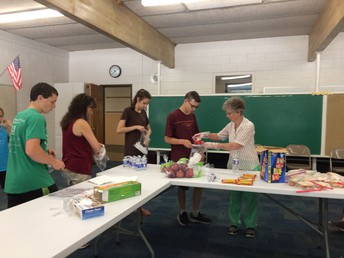 Making sandwiches for the Outreach Ministry