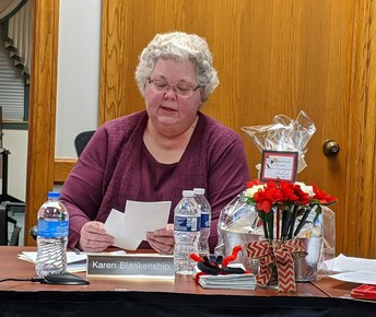 At the Jan. 13 BOE meeting, Board Vice President Mrs. Karen Blankenship reads School Board Recognition month gratitude cards from Chardon Middle School students.