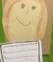 Mrs. Beutel's students write sentences to describe themselves.
