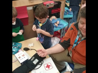 The Pre-K medical team takes Mr. Shea's blood pressure!