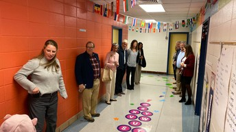 Our School Board members and honored guests enjoy the sensory path