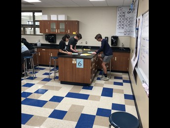 College Chemistry students conduct lab experiment