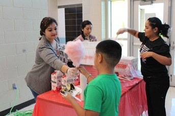 Mrs. Villarreal making cotton candy.