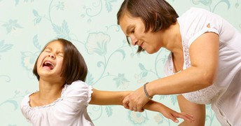 A mother is grabbing her kid, who is in pain, and smacking her