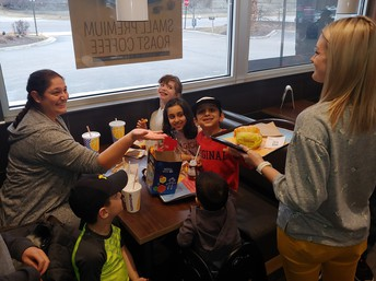 VO staff serving family during McDonald's Night