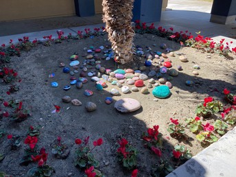 We need the rocks back to finish our new Kindness Rock Garden!