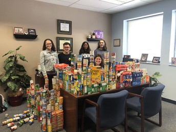 NJHS 'walling' Mrs. Fowler with the food donations.