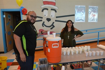 Mr. Moreno & Ms. Martinez serving punch