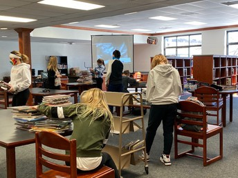 Students working with Mrs. Smith in the library.