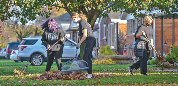 Students help rake neighbors' yards in St. Clair Shores
