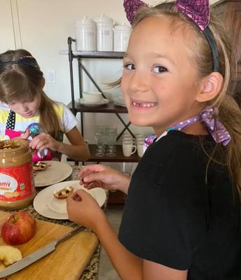 Emma making apple cookies in cooking club
