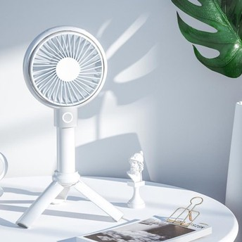 The Portable Misting Fan Keeps You Cool On-The-Go