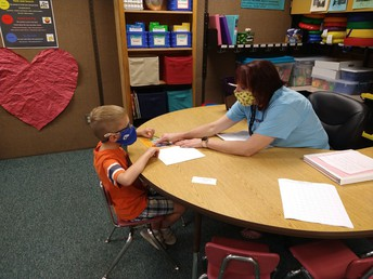 Mrs. Miller working with a student.