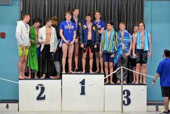 image of boys podium finishers with buffs on top