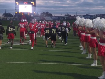 SMS football run out with THS football