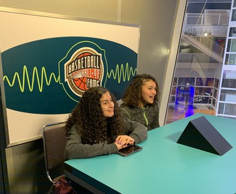 Yarimar Rivera and Ariana Lopez sit at the assignment desk, practicing their broadcast skills by using a teleprompter.  Special shout out to Mr. Sullivan who encouraged and demonstrated how to use the teleprompter.