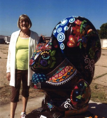 Mrs. Teresa with One of the Original Black Squirrel Statues