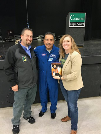 Former NASA astronaut is joined by Concord HS Vice Principal Ken Hickok and Principal Rianne Pfaltzgraff at his recent assembly.