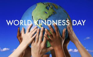 World Kindness Day logo with hands holding a world
