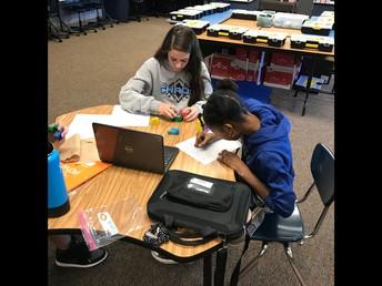 STEM Students Solving Puzzle Cubes