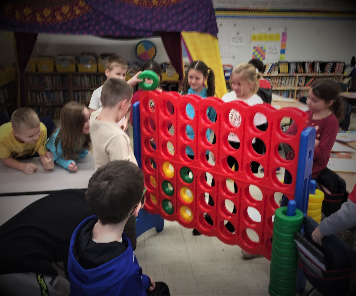 Students stand and play a life-size CONNECT FOUR game - provided as an incentive by Munson Elementary PTO.