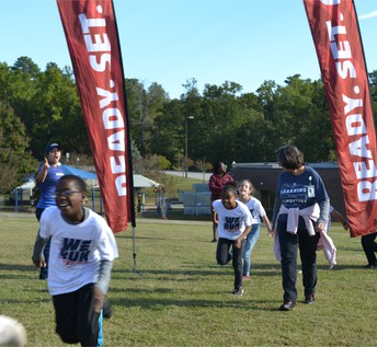 5th graders taking the field for Fun Run