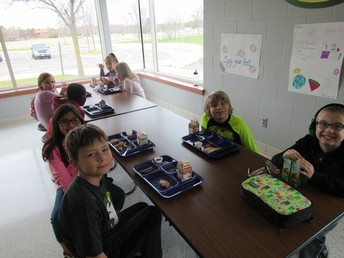 Students enjoy table time with friends at lunch.