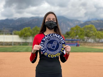 PUSD Student Holding the logo for the Pasadena COVID Vaccination Campaign