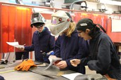 Students collaborating on project in Welding