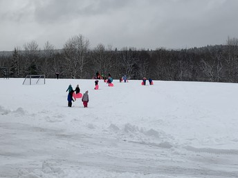 Going sledding during recess