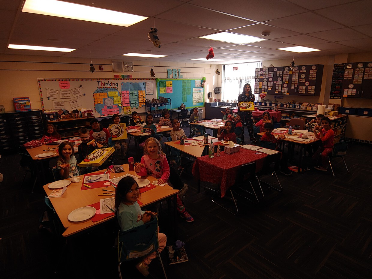 Ms. Rice's class enjoying a pizza party