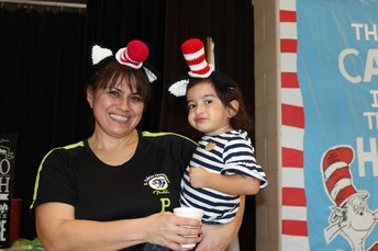 Mrs. Noriega & daughter enjoying event.