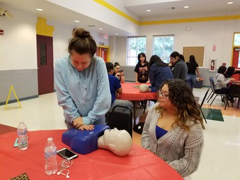From left: Brittany Rendon & Krystal Garza during campus CPR training event