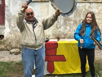 Elder David Serkoak shares drumming techniques with Raigilie and workshop attendees